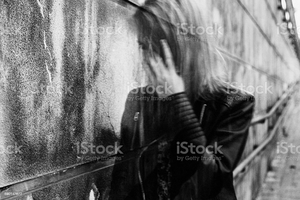 Young woman suffering from disorientation, confusion, or sadness. stock photo