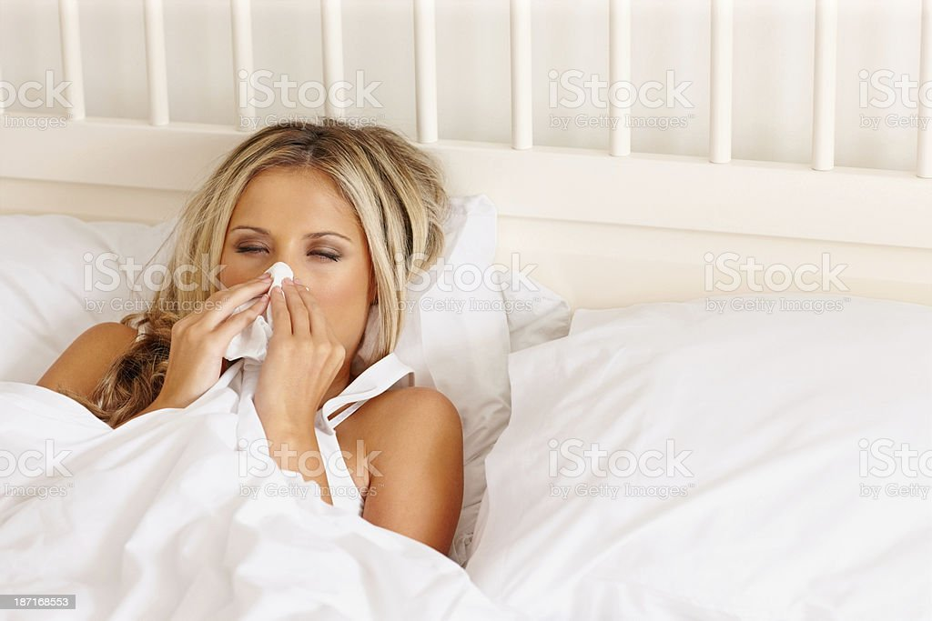 Young woman suffering from flu royalty-free stock photo
