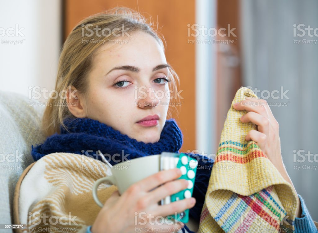 Young woman suffering of cold and having stuffy nose stock photo