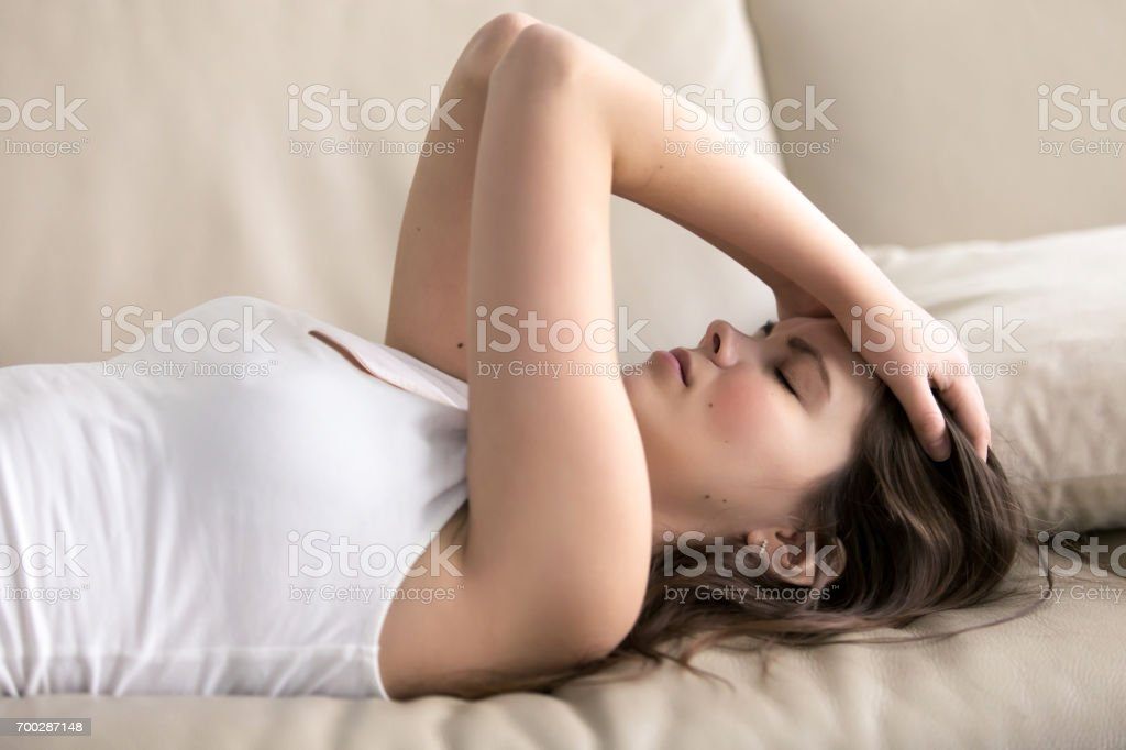 Young woman suffering of headache or migraine stock photo