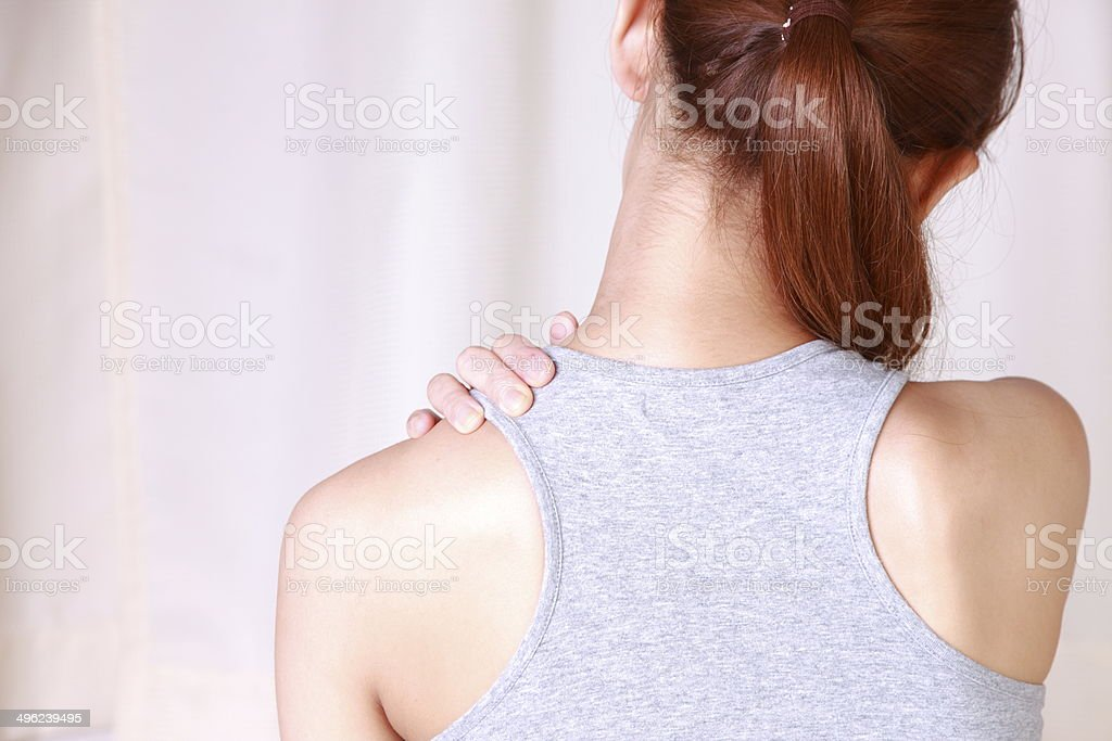 young woman suffers from stiff neck stock photo