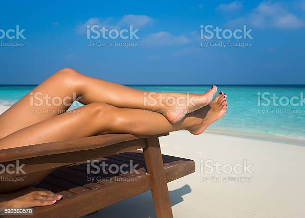Young woman sunbathing on lounger legs picture id592360570?b=1&k=6&m=592360570&s=612x612&h=r1u0j2rsmvv4zgd1s9x0hgtzby17u8gwfz4fl8sv3bq=