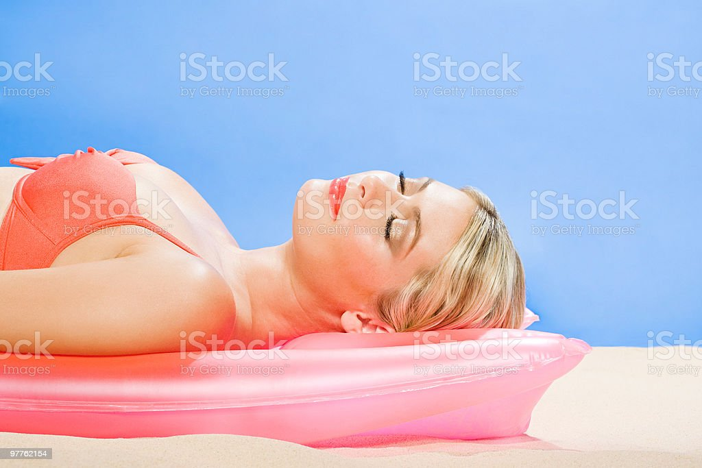 Young woman sunbathing royalty-free stock photo