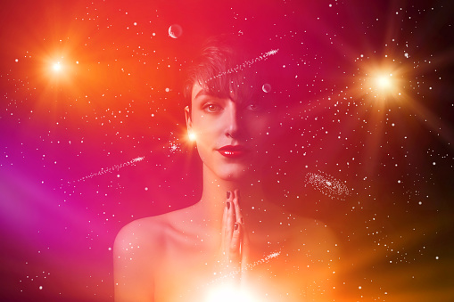 Young woman surrounded by the universe