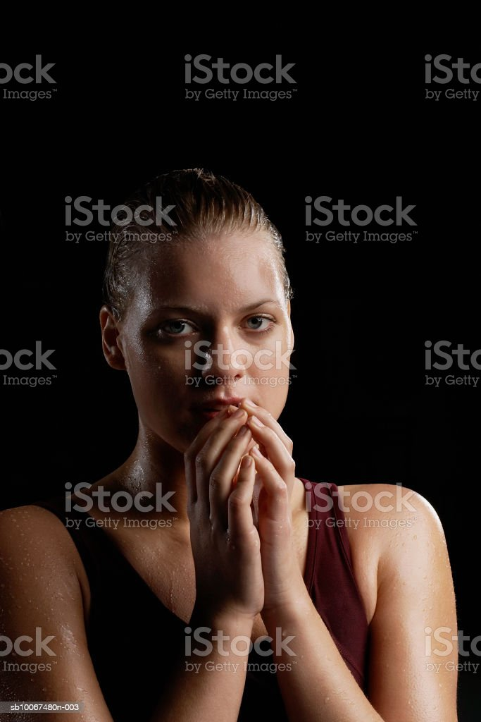 Young woman sweating, portrait, close-up royalty-free stock photo