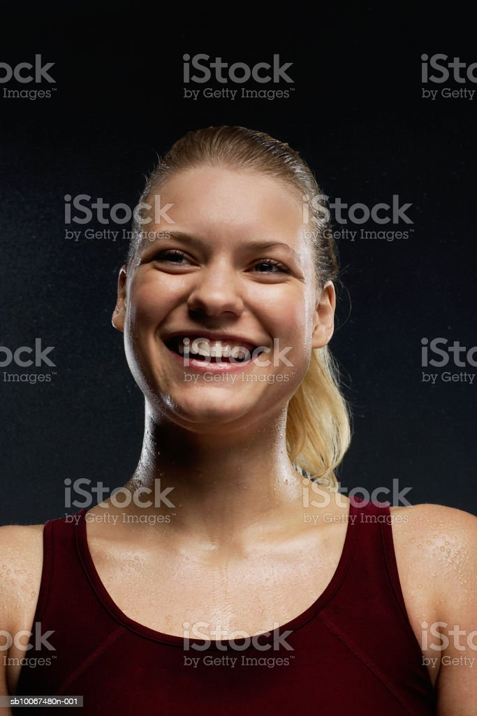 Young woman sweating, smiling, close-up royalty-free 스톡 사진