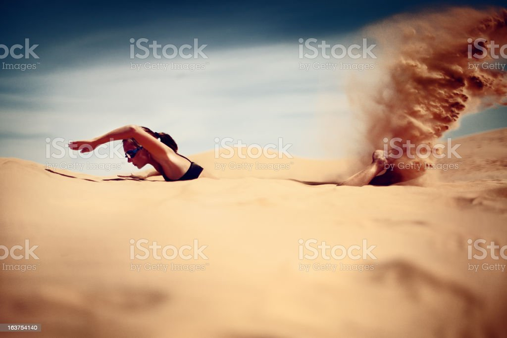 Young woman swim in desert royalty-free stock photo