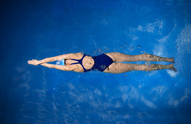 young woman swimmer - swimming stock pictures, royalty-free photos & images