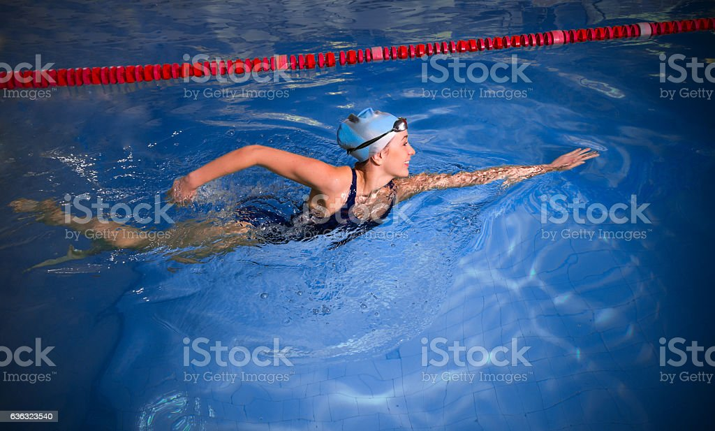Young woman swimmer stock photo