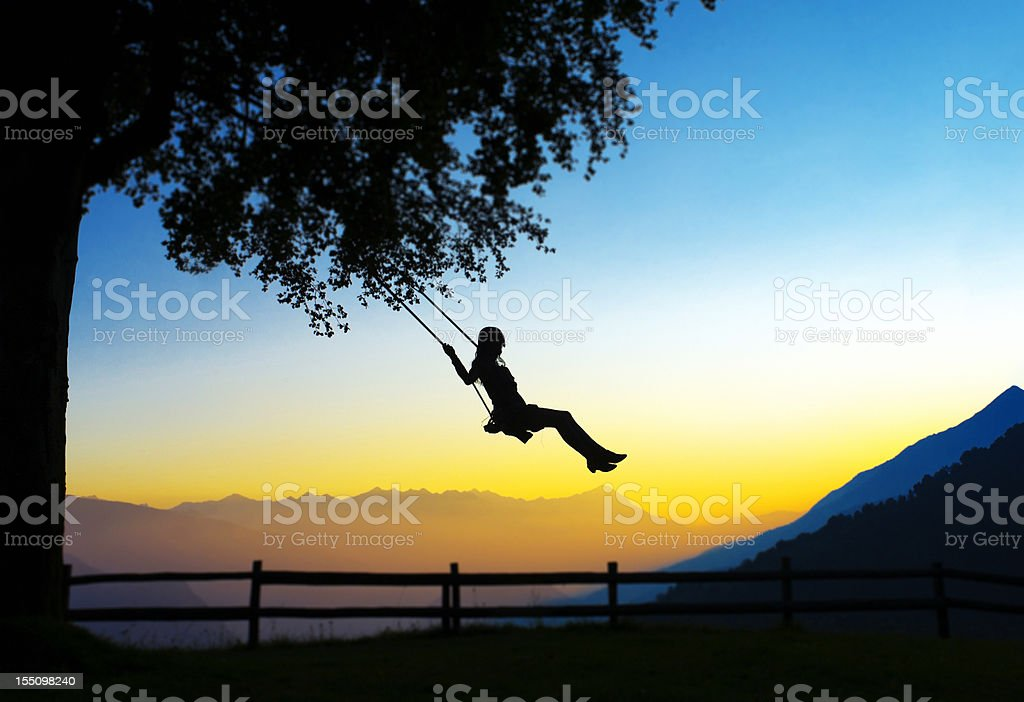 Young Woman Swinging silhouette royalty-free stock photo