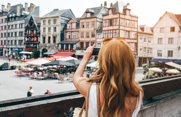 Young woman take photos in Rouen stock photo