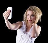 istock Young woman takes a selfie 466957976