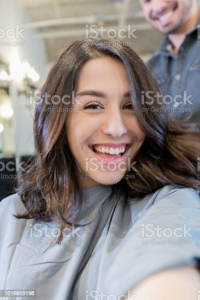 Young woman takes selfie of new hairstyle picture id1016655198?b=1&k=6&m=1016655198&s=612x612&h=hdh3krig30tqwkwfjzvduhmq60xbr9yne1mqezen wu=