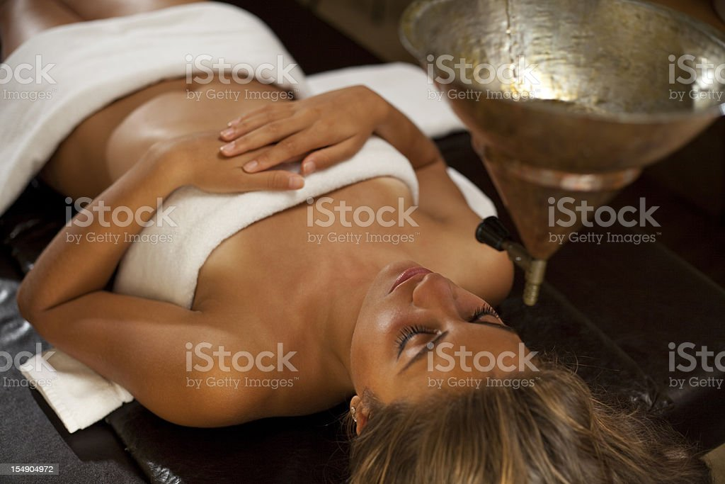 Young woman taking a ayurveda spa massage stock photo