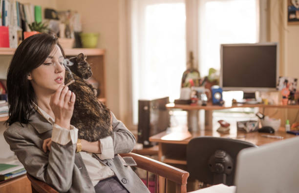 Young woman taking a cigarette break from work with her cat picture id884663632?b=1&k=6&m=884663632&s=612x612&w=0&h=s0p20zxz9nii7 jtv2fbpnv3sykiq4epbfyaokoynps=