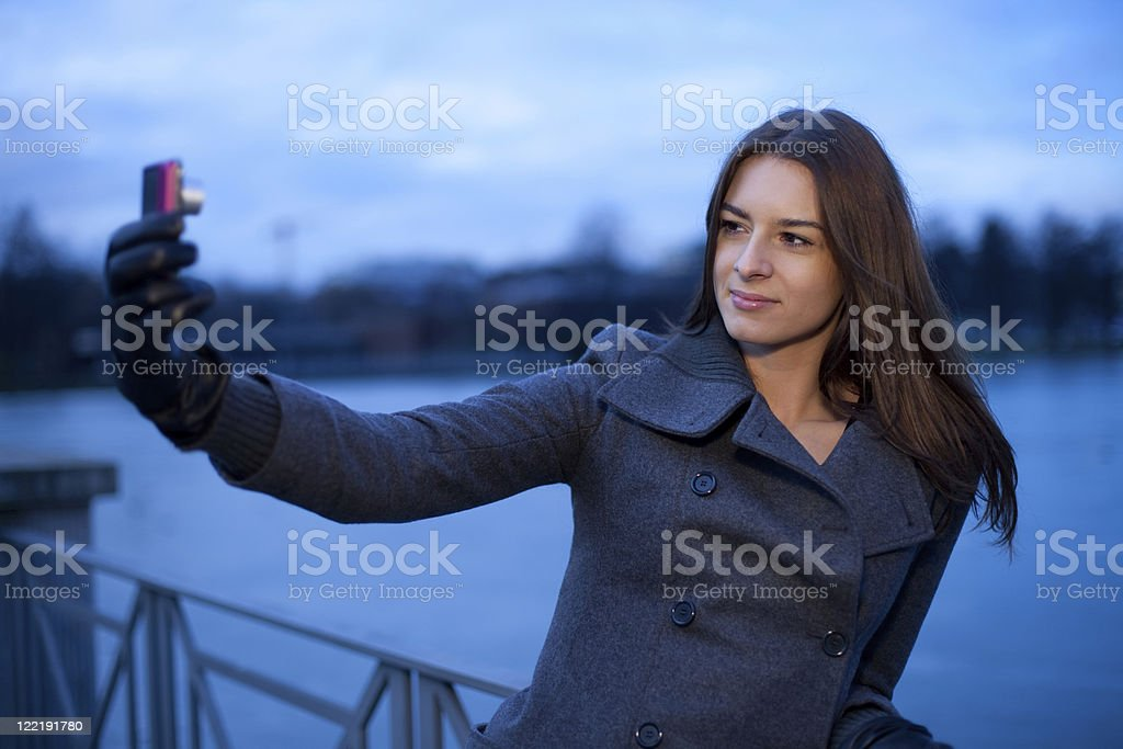 Young Woman Taking A Photo Of Herself royalty-free stock photo