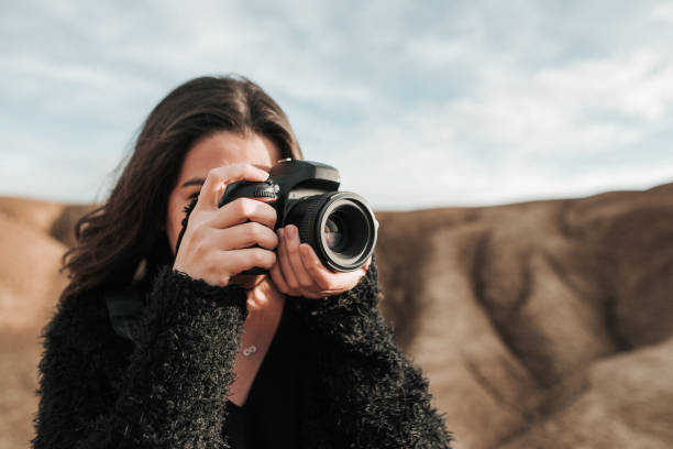 Young woman taking a picture picture id902480440?b=1&k=6&m=902480440&s=612x612&w=0&h=qe6kgoxwfobhqa 4p6tqtbs w92axz22eb9dtgt0gks=