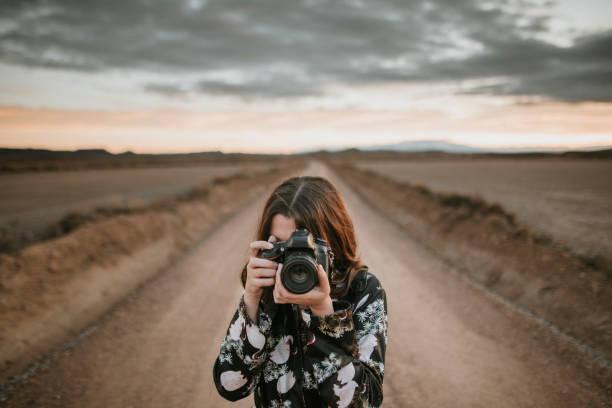 Young woman taking a picture picture id902506390?b=1&k=6&m=902506390&s=612x612&w=0&h=y6jzx64l8gzu tj62jb7neawlaz neeniagglk913oo=