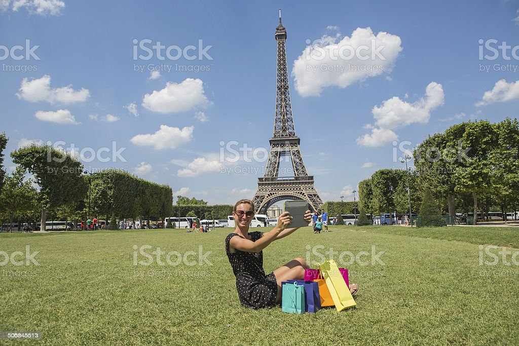 Young woman taking a selfie front of Eiffel tower royalty-free stock photo