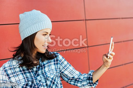518885222istockphoto Young woman taking a selfie 616239564