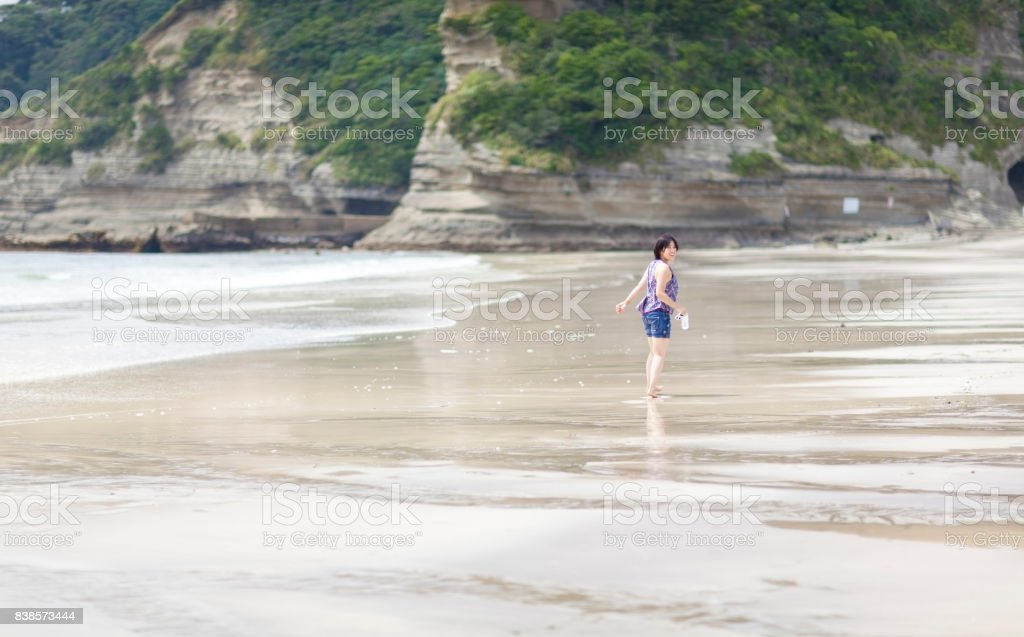 Young Woman Taking A Walk At Beach stock photo