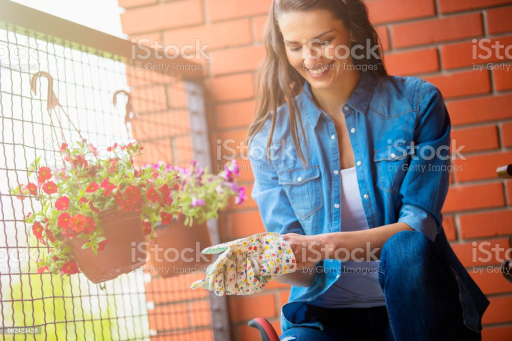 Young woman taking care of her flowers royalty-free stock photo