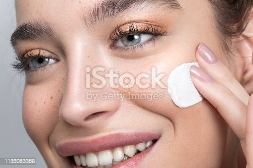 istock Young woman taking care of her skin 1133083356