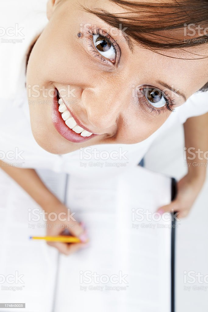 Young woman taking notes royalty-free stock photo