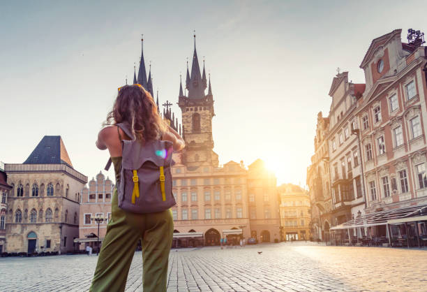 Young woman taking photo from the Tyn Church in Prague stock photo