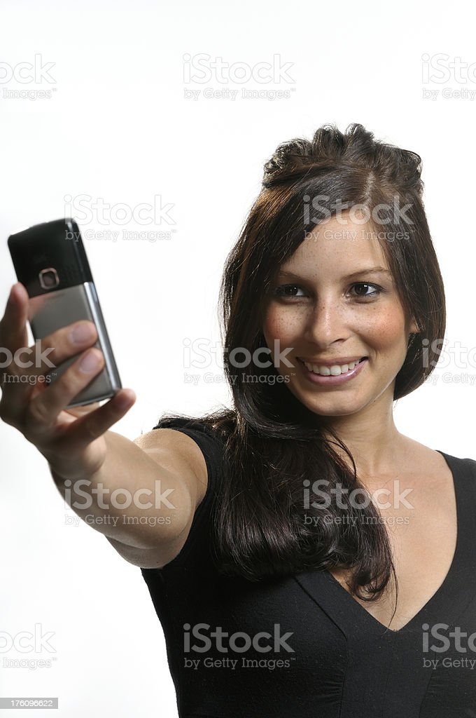Young woman taking picture with mobile phone stock photo