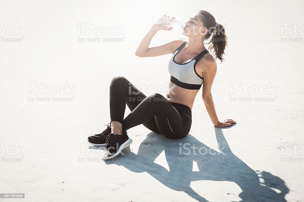 young woman taking refreshments stock photo