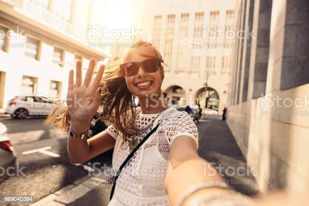 Young woman taking selfie in a street surrounded by buildings picture id669040394?b=1&k=6&m=669040394&s=612x612&h=u8bvhz00vru415eslfhupwoktpj rfkuvyvudf9qes8=