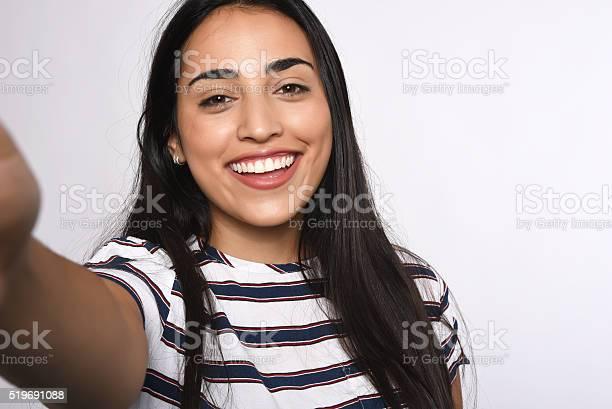 Young woman taking selfie picture id519691088?b=1&k=6&m=519691088&s=612x612&h=z1x2hjdp8zmjvpjblggayzszfp99iakxguvusv bhgu=