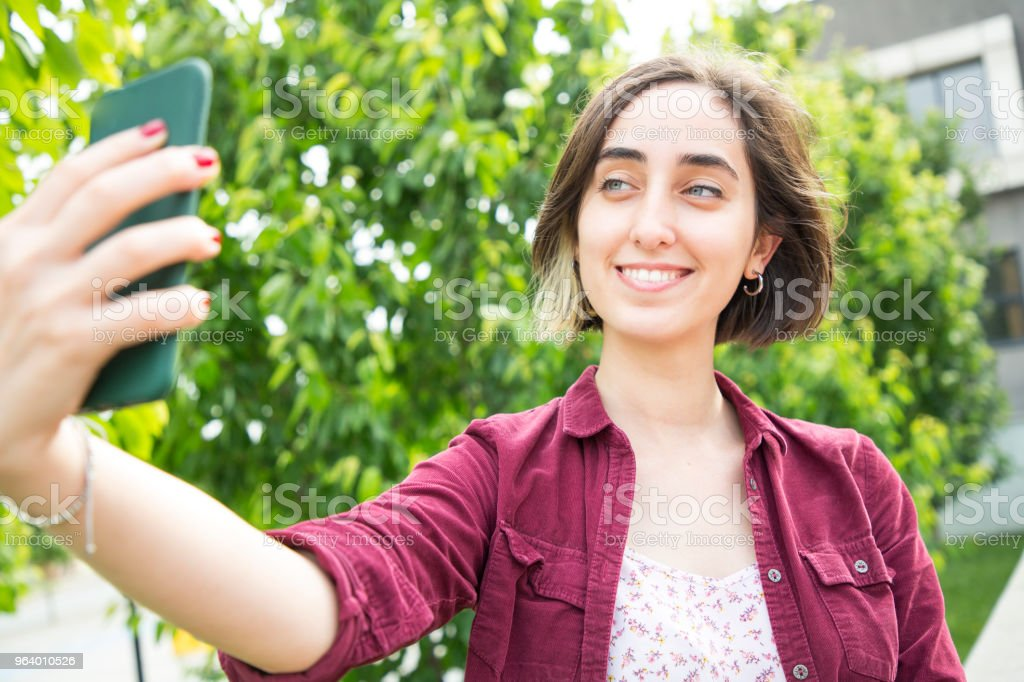 Young woman taking selfie - Royalty-free Adult Stock Photo