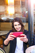 istock Young woman taking selfie with smart phone in cafe Paris 539246940