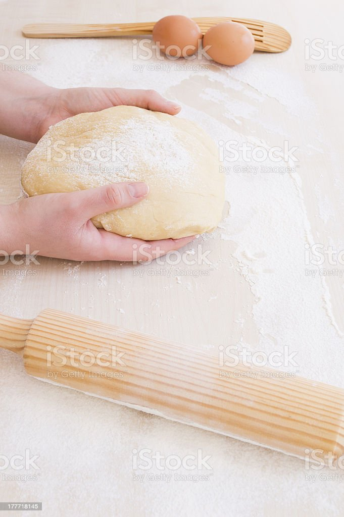 young woman taking the dough with both hands royalty-free stock photo