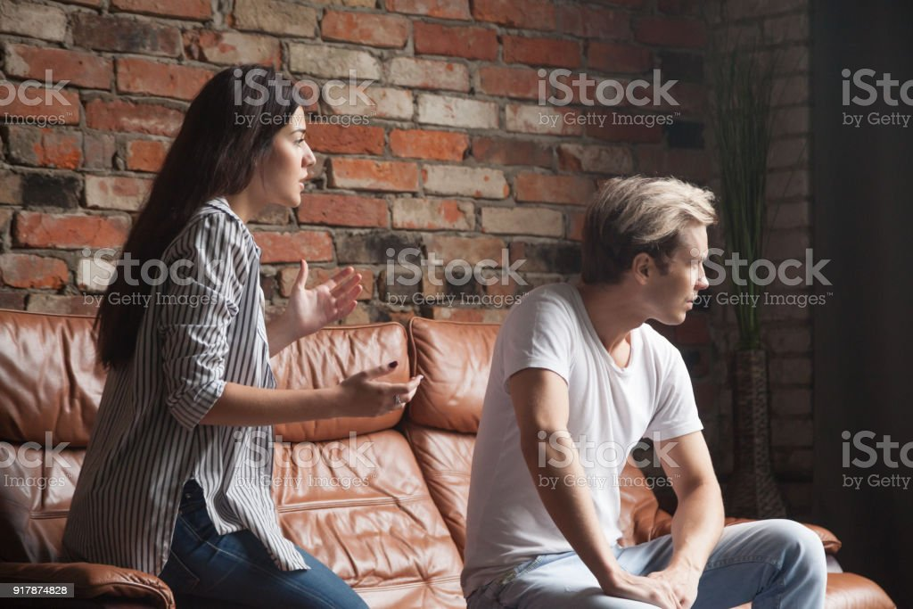 Young woman talking apologizing resentful man feels offended after conflict stock photo