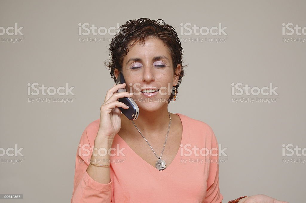 Young woman talking on cell phone royalty-free stock photo