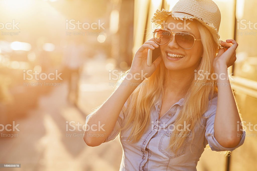 Young woman talking on mobile phone royalty-free stock photo