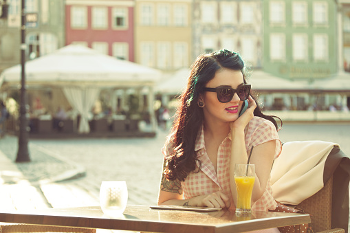 Young Woman Talking On Phone In The Outdoor Restaurant Stock Photo - Download Image Now