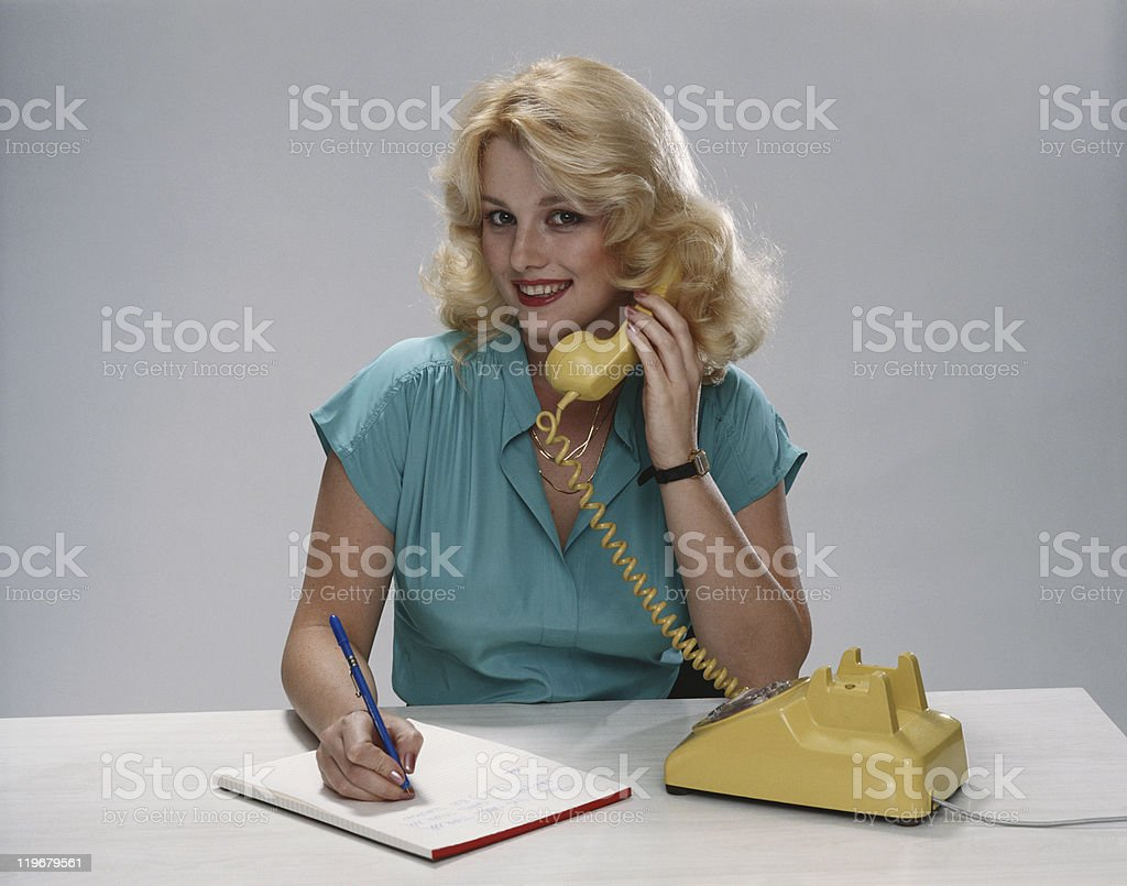Young woman talking on phone, smiling, portrait stock photo