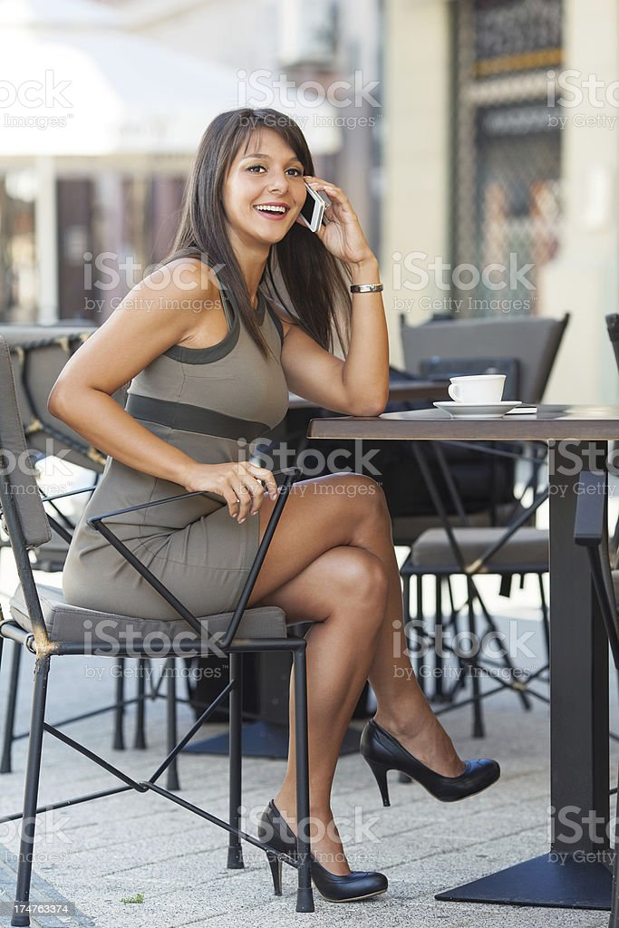 Young woman talking on the phone in a cafe royalty-free stock photo