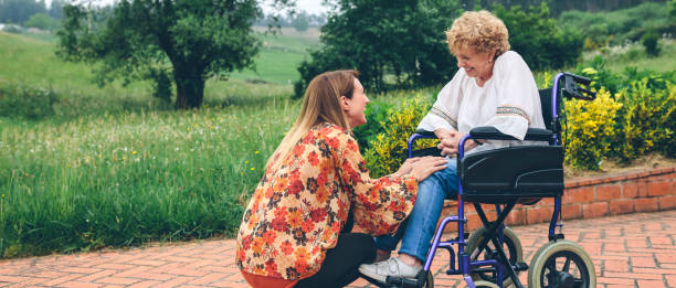 Young woman talking to elderly woman in a wheelchair picture id1134209750?b=1&k=6&m=1134209750&s=612x612&w=0&h=9vta2jxc4whxmrjwoles3ahnlly3hxxwyte7xzlb5ja=