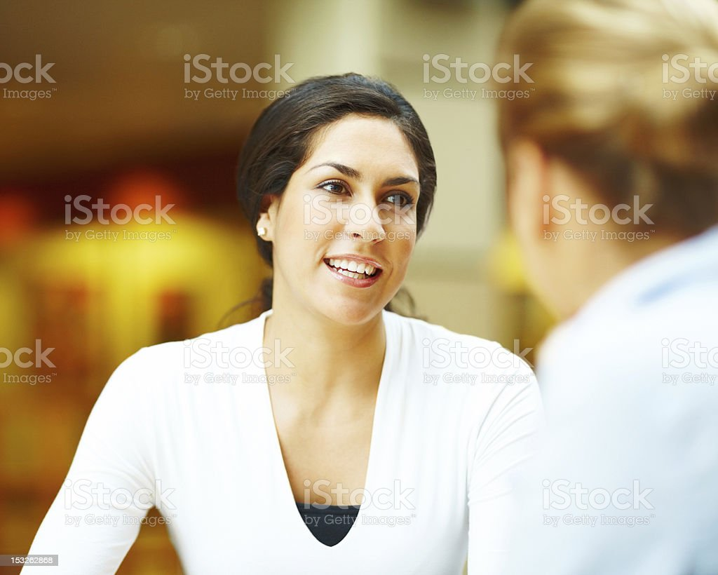 Young woman talking to her friend royalty-free stock photo