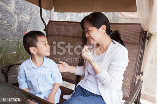 Young woman talking with child