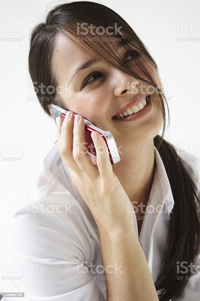 Young woman talks on cellphone royalty-free stock photo