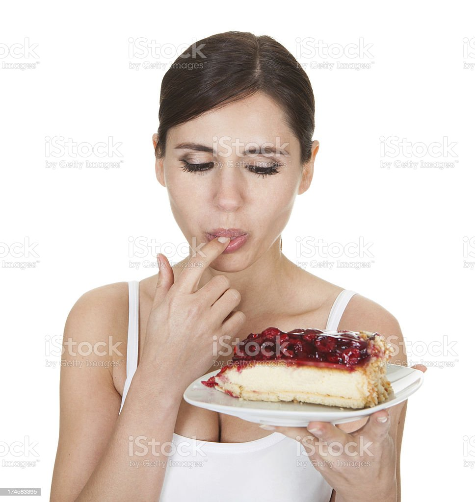 Young Woman Tasting Cake royalty-free stock photo