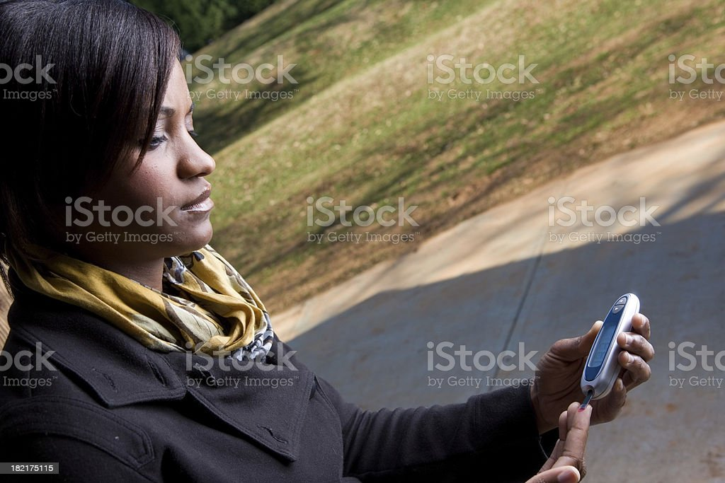 Young Woman Tests Blood Sugar stock photo