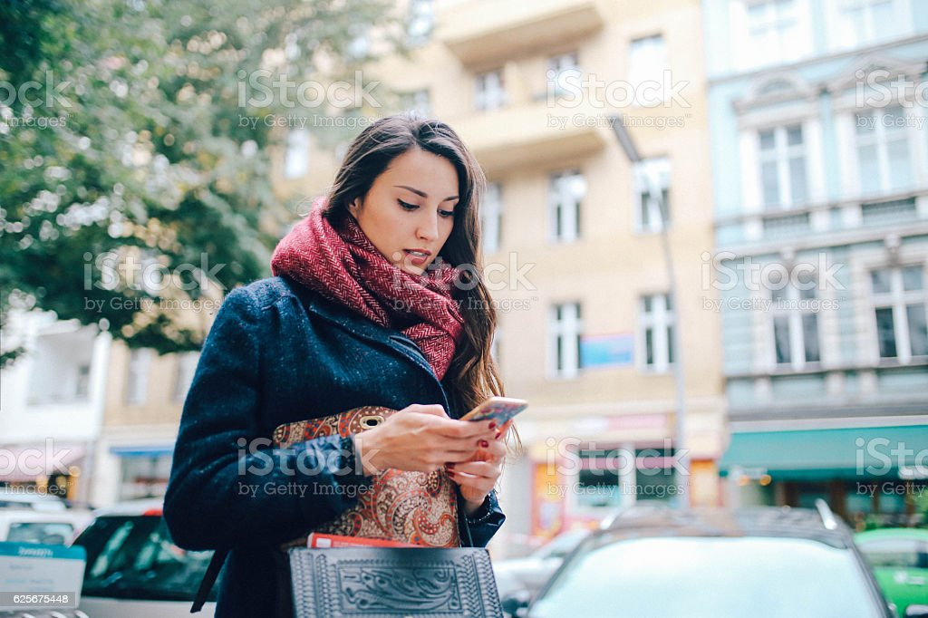 Young woman texting in Berlin stock photo