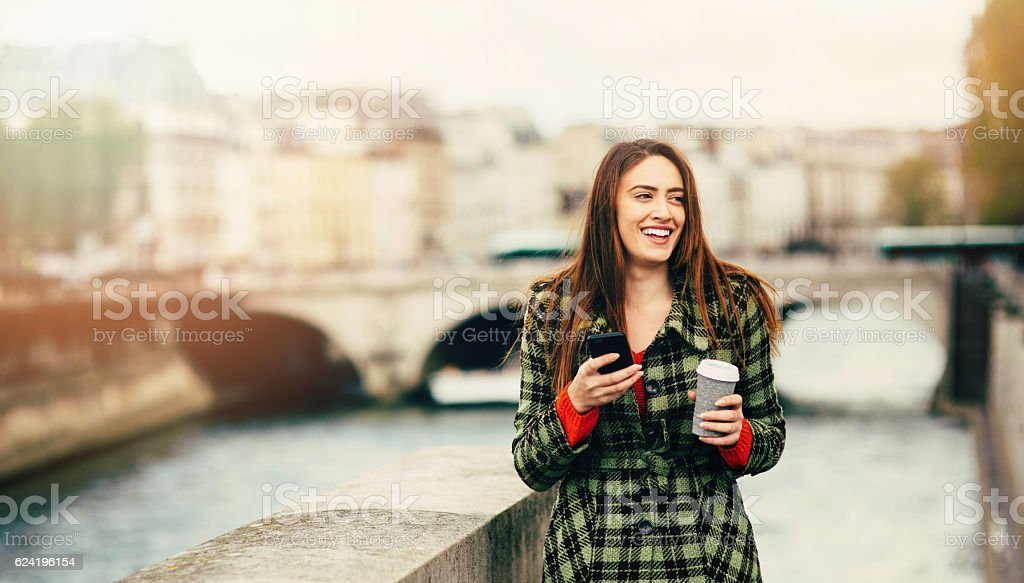 Young woman texting in Paris stock photo